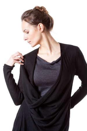 Lady fastening oversized sweater on isolated background