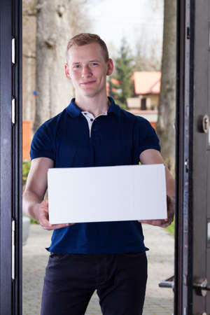 Order delivered by handsome and smiling courier photo