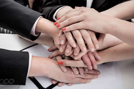 A pile of hands of businessman during a meeting photo