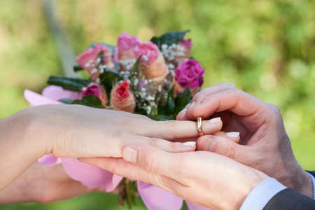 vow: A close up of a couple tying the knot Stock Photo