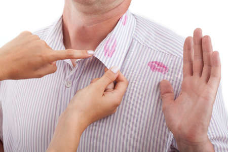 untrustworthy: A sign of betrayal on a mans shirt Stock Photo
