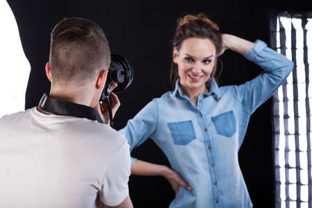 showbusiness: Fashion photographer during work with beautiful model Stock Photo