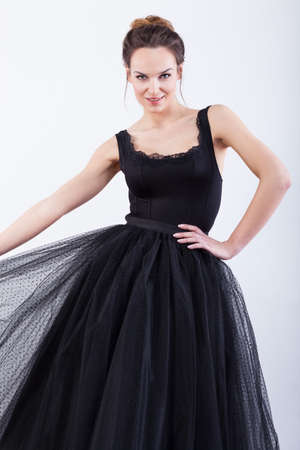 showbusiness: Beautiful, young, female model in black dress Stock Photo