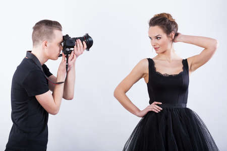 showbusiness: Man with camera taking a photo of a beautiful woman