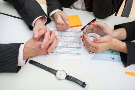 new strategy: Closeup of a business people hands discussing a new strategy Stock Photo