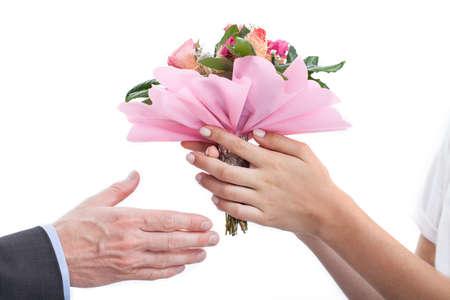 recieving: A closeup of womans hands accepting a bouquet of roses