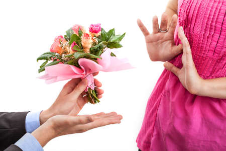 apology: Offended woman and man with flowers for apology