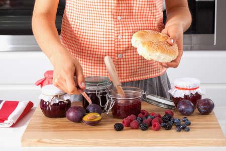 Women preparing meal with homemade jam photo