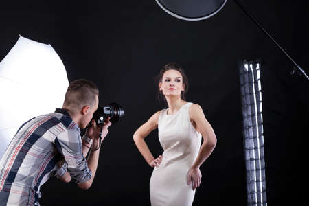 fashion shoot: Movie star having a photo session with a photographer