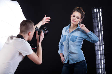 studio shoot: Top model posing in casual clothes for a fashion magazine