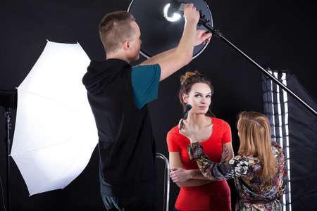 showbusiness: Photographer fixing a flesh light in studio  Stock Photo