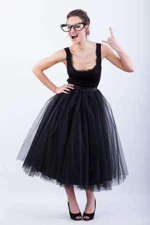 showbusiness: Top model wearing a big funny glasses and black dress