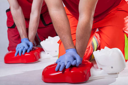 reanimation: First aid course on white isolated background Stock Photo