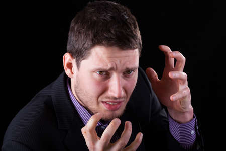 professionalist: A closeup of a frustrated angry businessman in a suit Stock Photo