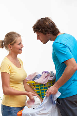 Husband is helping wife to ironing his clothes photo
