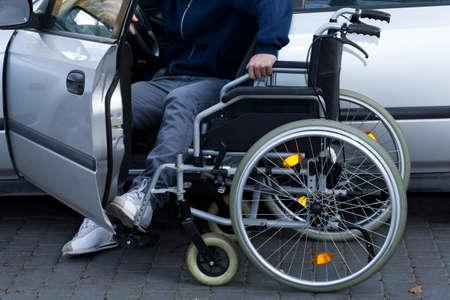 Disabled man preparing to drive a car, horizontal photo