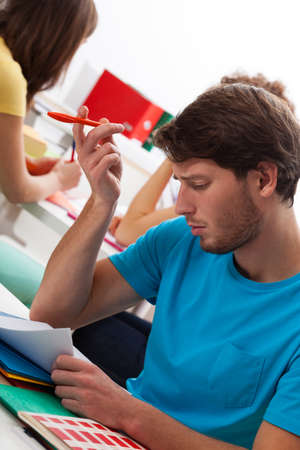 difficult task: Handsome male student cant solve difficult task