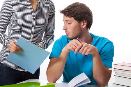 private schools: Student talking with teacher on isolated background Stock Photo