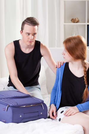 red haired girl: Young couple few moments befour sad departure Stock Photo