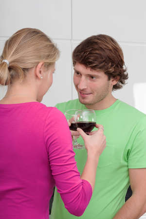 Young people in love drinking red wine photo