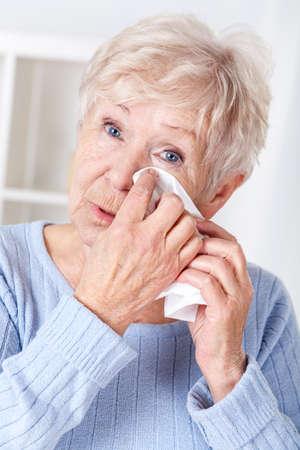 sad eyes: Portrait of sad elderly woman crying,vertical Stock Photo