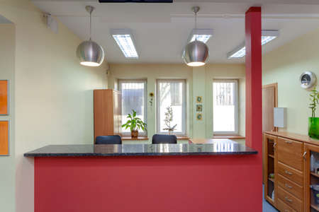 Reception desk in small medical clinic, horizontal photo