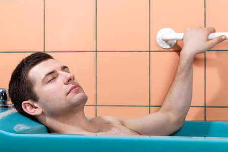 therapeutic massage: Man having therapeutic massage in water, horizontal Stock Photo