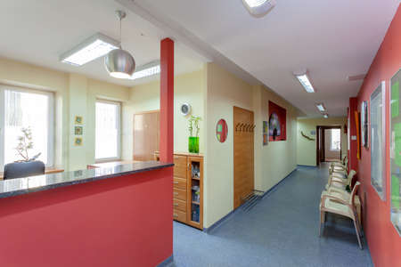 Waiting room with reception in medical clinic photo