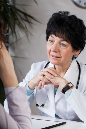 professionalist: A doctor talking to her patient in her surgery Stock Photo