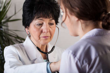 professionalist: A patient visiting a doctor for a routine examination Stock Photo
