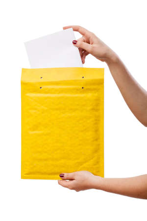 Yellow envelope with white empty card inside Stock Photo