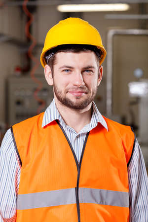 Engineer standing in production area in factory photo