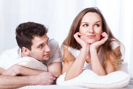 stubborn: A stubborn confident woman and a loving shy man lying in bed