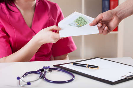 corruptible: Close-up of a doctor taking bribe, horizontal