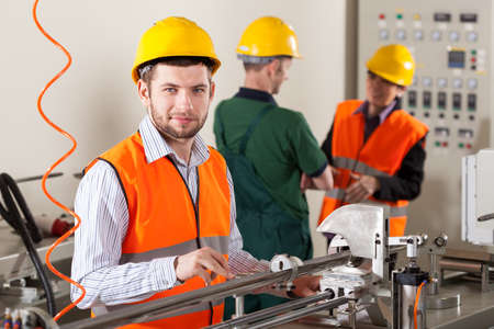 Male production workers working during production process Stock Photo