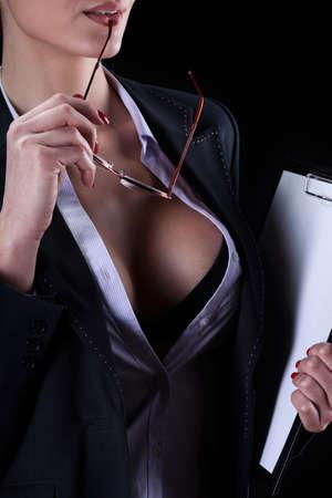 erotico: Vista di una segretaria sexy con seno bello Archivio Fotografico