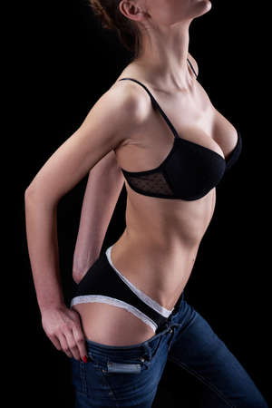 Seductive woman during undressing on isolated background photo