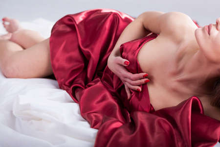 Horizontal view of erotic moments in bed photo