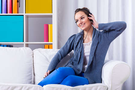 homey: Woman learning foreign language in her home by using mp3 player