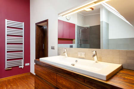 Double washbasin on wooden counter in bathroom photo
