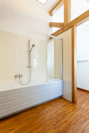 Interior of wooden and modern bathroom, vertical photo