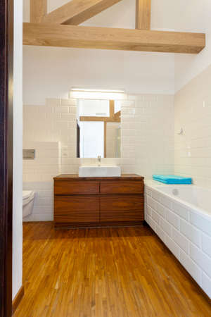 Vertical view of classic and designed bathroom photo