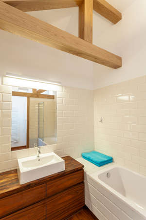 White sink on a wooden cupboard, vertical photo