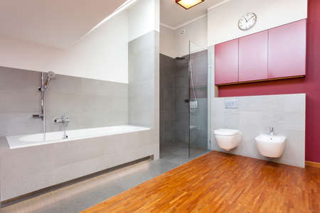 Red and grey modern bathroom with wooden floor photo