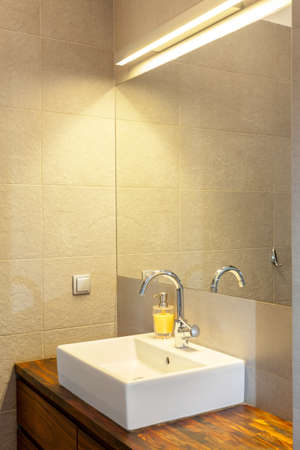White sink in a modern bathroom, vertical photo