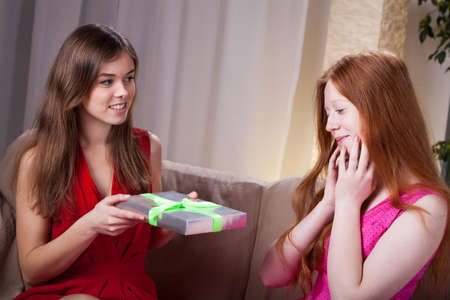 Woman giving her best friend gift for birthday photo