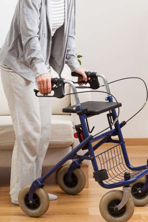 Disabled lady during walking with walker, vertical Imagens - 28347627