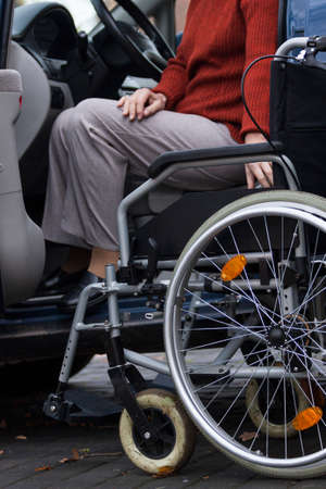 Disabled lady on wheelchair ready to drive photo