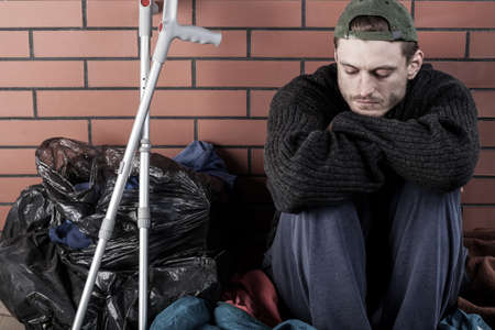 unhealthy living: Disabled and homeless man living on the street