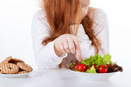 Close-up of a girl making healthy diet choices photo